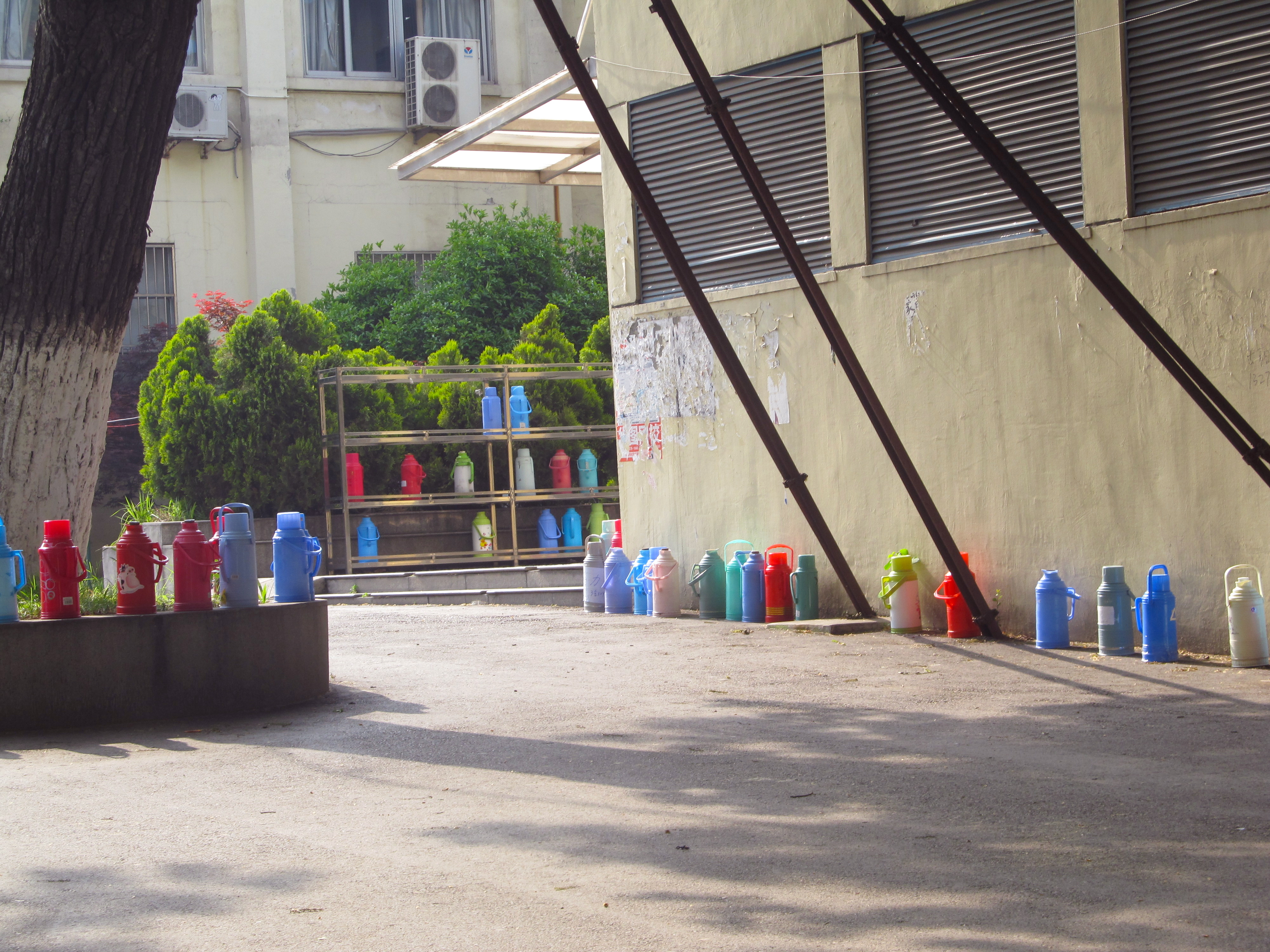 Hot water thermos bottles waiting to be filled on Nanjing University's campus.