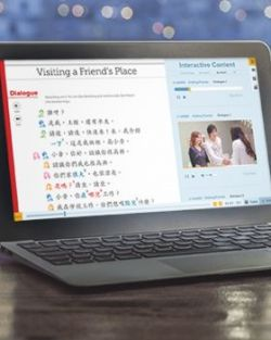 A laptop showing the Web App with Integrated Chinese